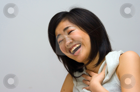Laughing Oriental woman stock photo, Beautifull Oriental woman in a white collared shirt laughing by Paul Hakimata