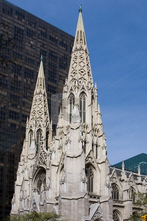 St. Patrick Cathedral stock photo, The facade of the Saint Patrick Cathedral in New York City, on a deep blue sky by Paul Hakimata