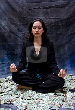 Financial meditation stock photo, Rich woman meditating while sitting in money isolated on a dark background by Paul Hakimata