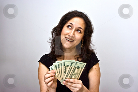 Counting money stock photo, Women counting money and thinking what she can do with it by Paul Hakimata