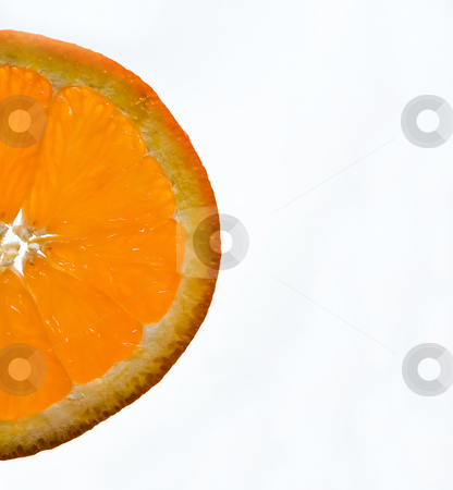 Orange wedge stock photo, A half wedge of orange or mandarine isolated on white by Paul Hakimata