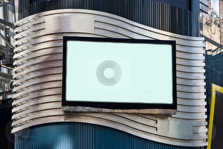 Advertisement LCD TV stock photo, A LCD TV on a building for advertisement; used as a billboard; frame with black border; on a silver colored waved background. by Paul Hakimata