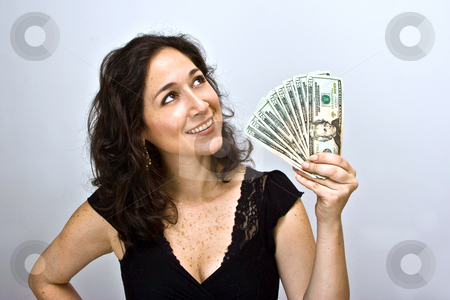 Woman waving money stock photo, Woman waving money and looking up, on a white background by Paul Hakimata