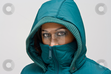 Young woman with green hood stock photo, A young woman wearing a green winter coat using the hood to cover her head so that only her eyes are visible, isolated on white by Paul Hakimata