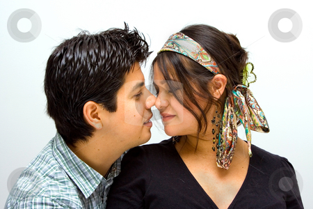 A romantic couple touching noses stock photo, A completely in love couple. by Paul Hakimata