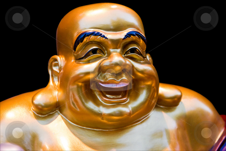 Smiling Buddha stock photo, The gold colored face of a statue of a smiling Buddha, isolated on black by Paul Hakimata