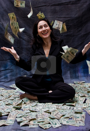 Woman receiving money stock photo, Rich woman sitting with open arms in money and as money falls out of the sky isolated on a dark background by Paul Hakimata