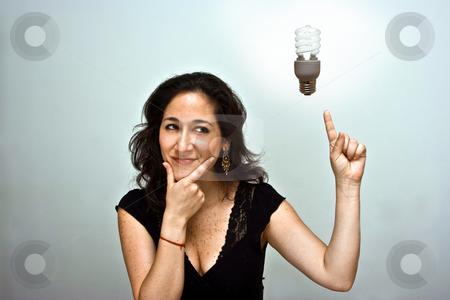 Think environment stock photo, Woman having a brilliant environmentally friendly idea by Paul Hakimata