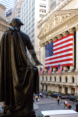 George Washington at New York Stock Exchange stock photo, A statue of former President George Washington pointing towards the American Flag hanging on the New York Stock Exchange building on Wall Street by Paul Hakimata