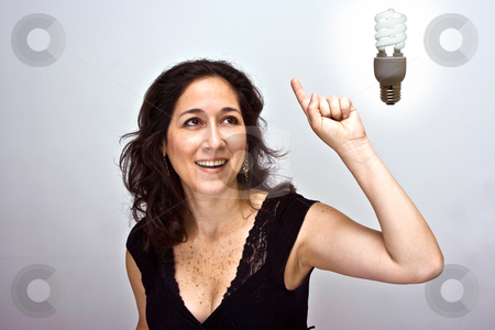 Great idea symbol stock photo, Woman having a brilliant environmentally friendly idea by Paul Hakimata
