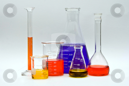Colorful Chemistry stock photo, Flasks, cylinders and beakers with colorful liquids as pH indicators on a white background by Paul Hakimata