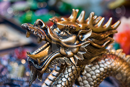 Golden dragon stock photo, A statue of a golden dragon's head by Paul Hakimata