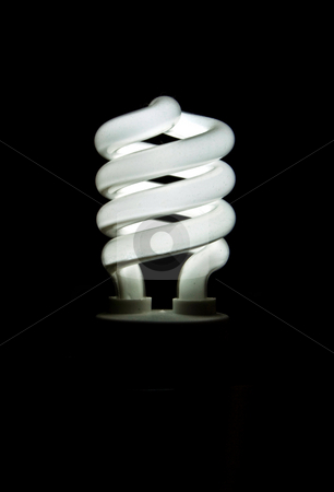 Power saver stock photo, A glowing fluorescend light bulb that is environmently friendly and saves money. by Paul Hakimata