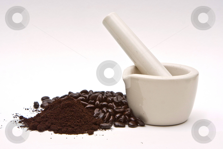 Mortar, coffee beans and grind stock photo, A mortar with freshly roasted gourmet coffee beans and grind isolated on a white background by Paul Hakimata