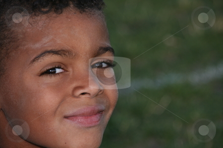 Mixed race boy stock photo, Head shot, Close up of mixed race boy after playing with dirt on his face by Robin Russell