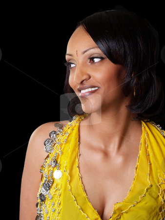 Woman looking away stock photo, Young black woman in yellow top looking off portrait by Jeff Cleveland
