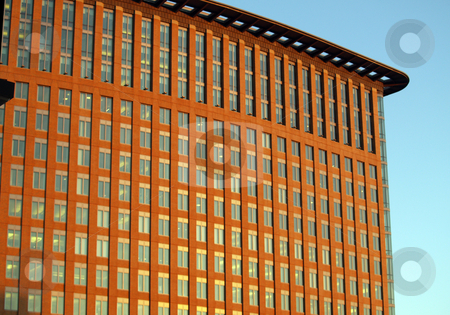 Red building with lots of windows in blue sky stock photo, Grid of windows in blue sky building by Jeff Cleveland