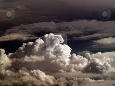 Ominous clouds from 32000 feet cumulus buildup stock photo, Cumulus clouds from the air ominous looking by Jeff Cleveland
