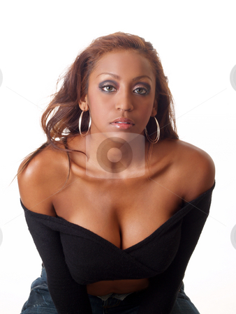 Woman leaning forward stock photo, Young black woman with bare shoulders serious look by Jeff Cleveland