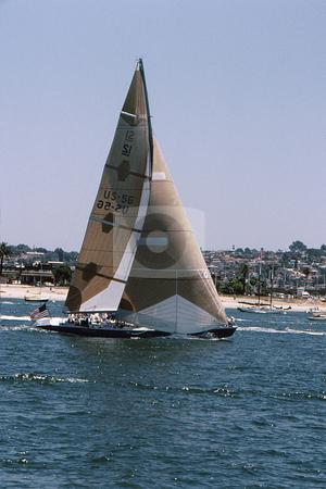 Racing sailboat stock photo, Large racing sail craft with full billowing sails by Joseph Ligori