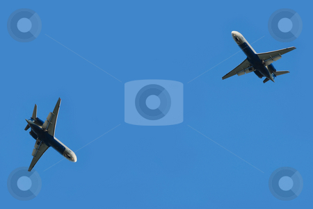 Two flying planes stock photo, Two flying planes isolated over blue sky by Julija Sapic