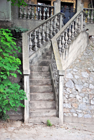 Stone stairs stock photo, Gray narrow concrete stairs over stone wall by Julija Sapic