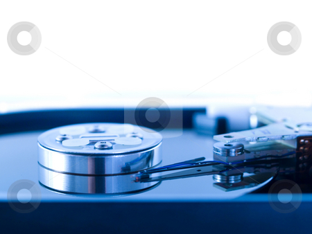 Open hard drive disk stock photo, Blue toned macro of an open hard drive disk by Laurent Dambies