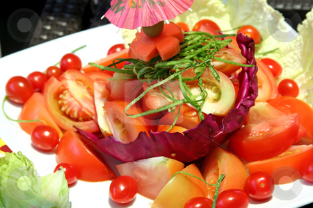 Sliced tomatoes stock photo, Sliced tomato lettuce salad fresh raw vegetables by Kheng Guan Toh