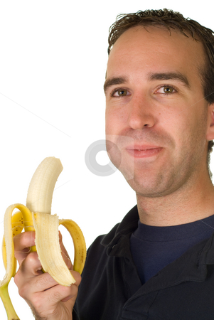 Banana Man stock photo, A man chewing a fresh banana, isolated on a white background by Richard Nelson