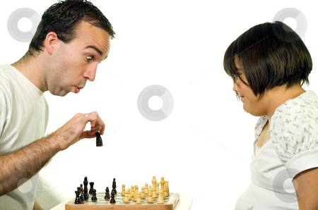 Teaching Chess stock photo, A young man teaching his daughter how to play chess by Richard Nelson