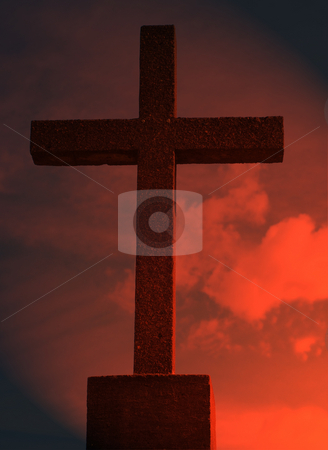 Religious Cross stock photo, A religious cross shot against a red sky by Richard Nelson