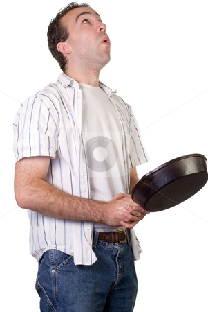 Flipping Pancakes stock photo, A man with a frying pan, flipping food into the air by Richard Nelson