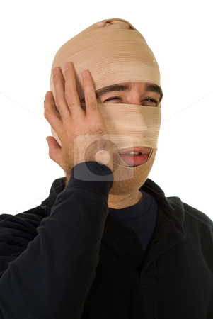 Surgery Patient stock photo, A man wearing tensor bandages on his face by Richard Nelson