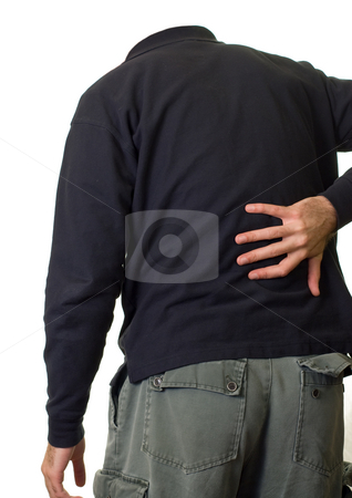 Back Ache stock photo, A person holding their lower back in pain by Richard Nelson