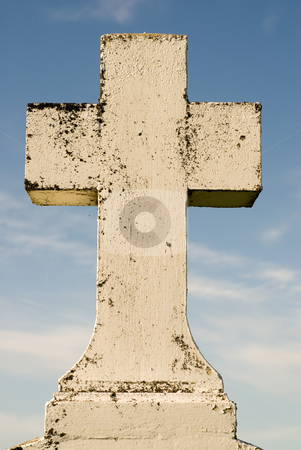 Stone Cross stock photo, A burial cross shot against a blue sky by Richard Nelson