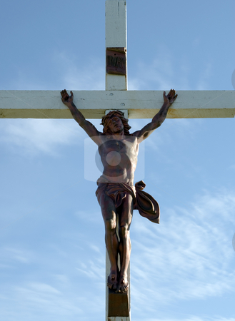 Crucifix stock photo, Low angle view of jesus staked on a cross by Richard Nelson