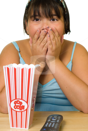 Scary Movie stock photo, A young girl watching a scary movie alone by Richard Nelson