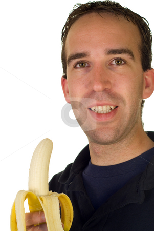 Healthy Eating stock photo, A young man holding a peeled banana by Richard Nelson