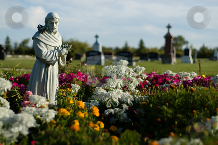 Holy Land stock photo, A spiritual cemetery with a stone statue surrounded by flowers by Richard Nelson
