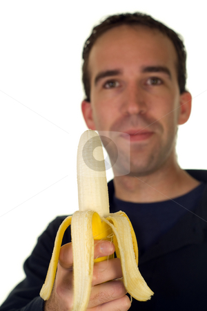 Banana stock photo, A young caucasian man holding a banana by Richard Nelson
