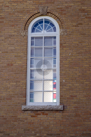 Church Window stock photo, A small church window built into some bricks by Richard Nelson