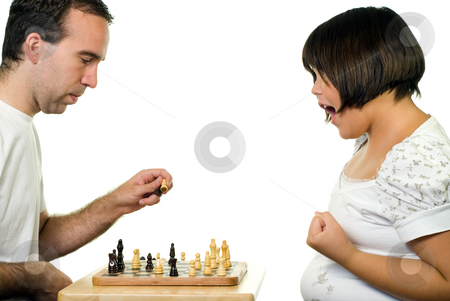 Girl Winning Chess Game stock photo, A young girl winning a chess game, isolated against a white background by Richard Nelson