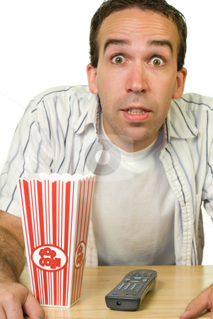 Man Watching Good Movie stock photo, A man looking excited while watching a movie by Richard Nelson