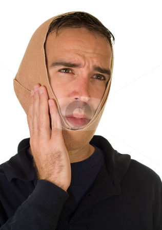 Tooth Ache stock photo, A man wearing a tensor bandage on his head by Richard Nelson