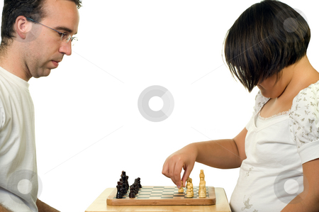 Father Daughter Playing Chess stock photo, A father and his daughter playing a game of chess by Richard Nelson