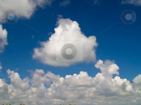 White Clouds In A Blue Sky stock photo, White Clouds in A Bright Blue Sky by Johan Knelsen