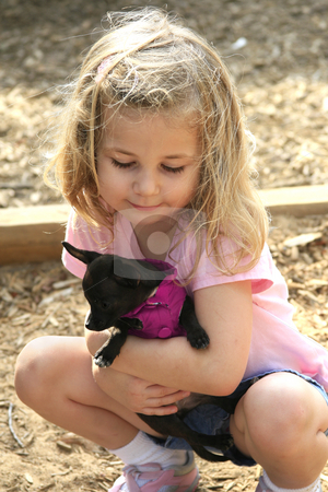 Little girl with dog stock photo, Little girl holding a tiny puppy by Anita Peppers