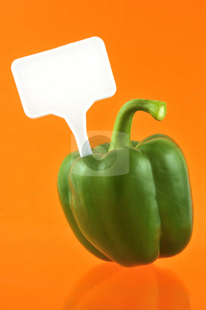 Green paprika stock photo, Green paprika against orange background with price tag by Csaba Zsarnowszky
