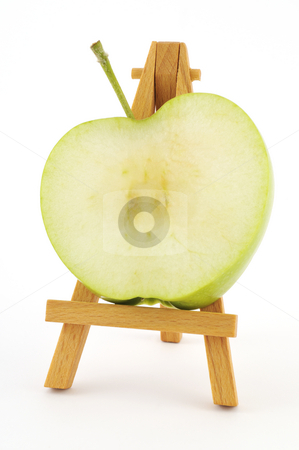 Apple slice stock photo, Green apple slice on wooden easel by Csaba Zsarnowszky