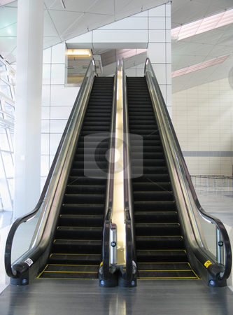 Black escalator stock photo,  by Mbudley Mbudley